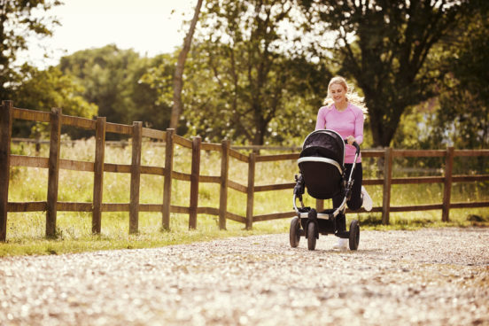 Mother Exercising By Running and Pushing a Baby Buggy