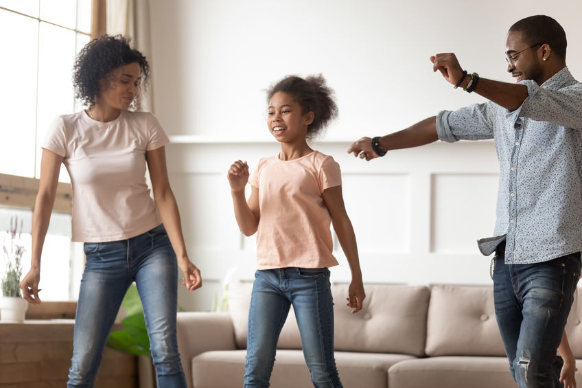 Family dancing at home